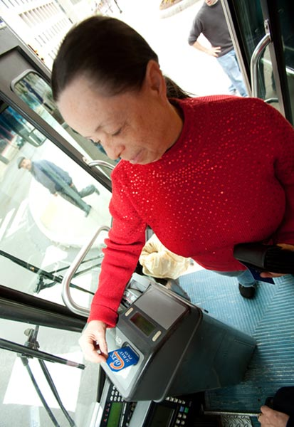 Woman paying bus fare