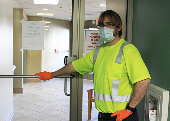 Maintenance staff cleans high touch areas in our offices