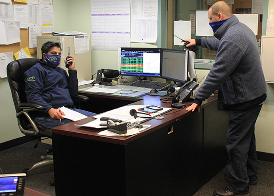 Dispatchers practice social distancing and wear masks
