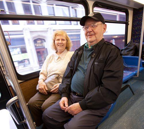 Couple riding bus